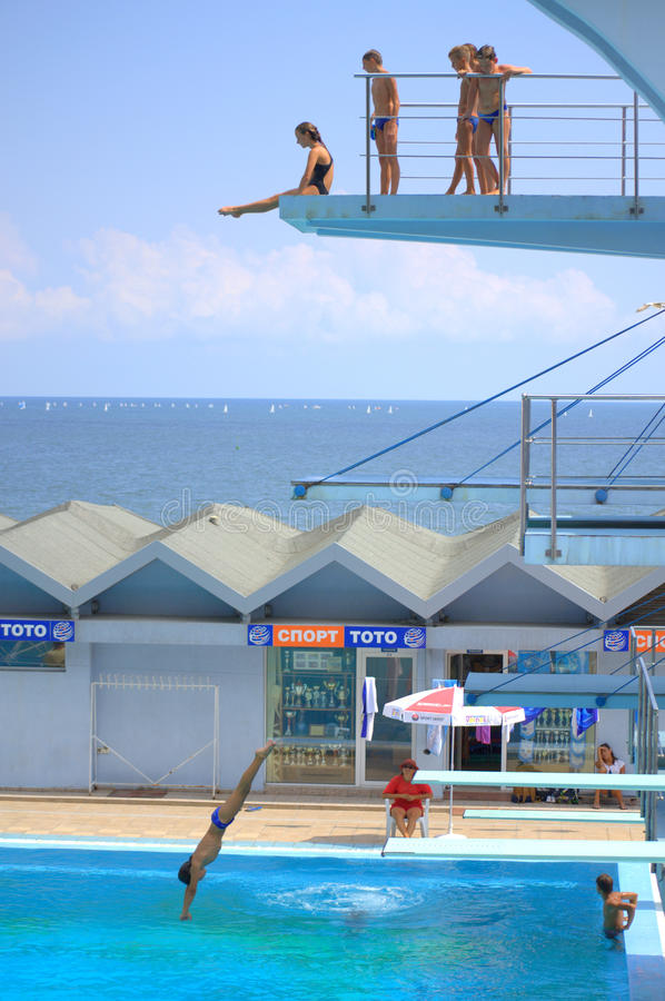 Boys And Girls On Diving Boards Of Outdoor Swimming Pool Diving Or Ready To  Jump,Varna City,Bulgaria