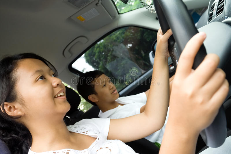 Teens enjoy driving a car royalty free stock images