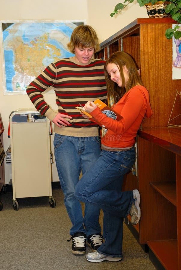 Teens flirting in Library
