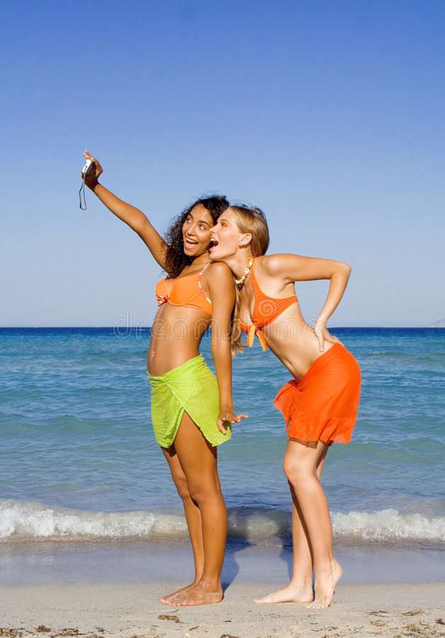 Teens fun on beach vacation royalty free stock photo