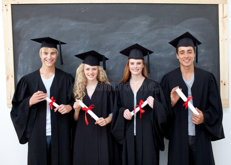 Teens after graduation royalty free stock photos