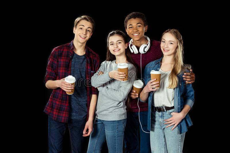 happy group of teens with cups of coffee to go royalty free stock photo