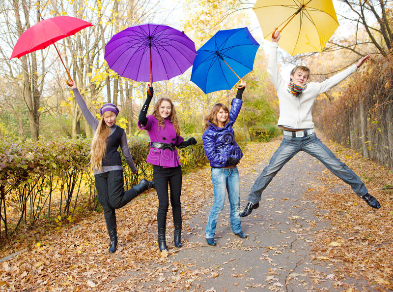 Teens jumping stock photo