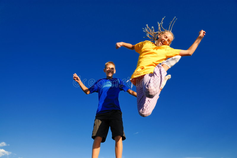 Download Teens jumping into the air stock image. Image of friend - 3649821