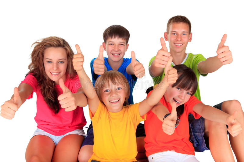 Teens and Kids with Thumbs Up. Children and teenagers in a line with the thumbs up sign, isolated on white royalty free stock photos