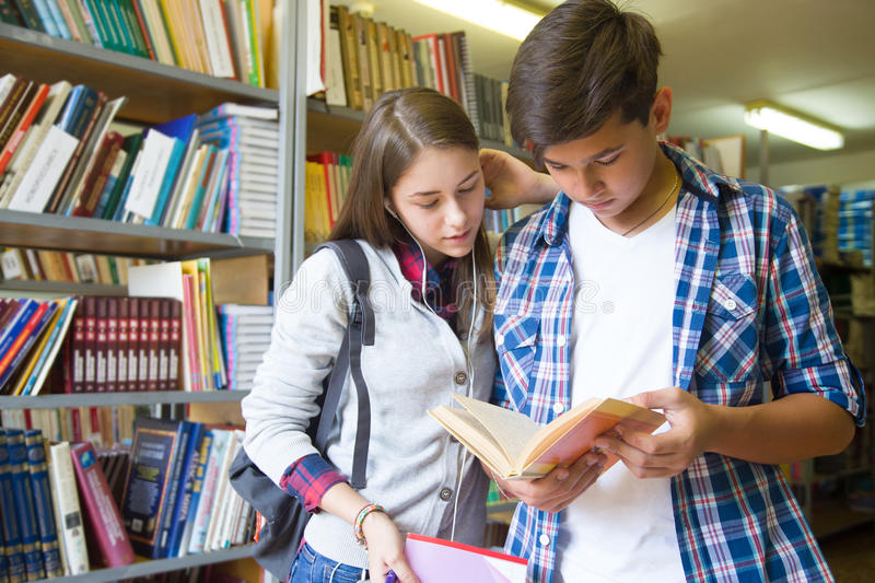 Teens in library stock photo