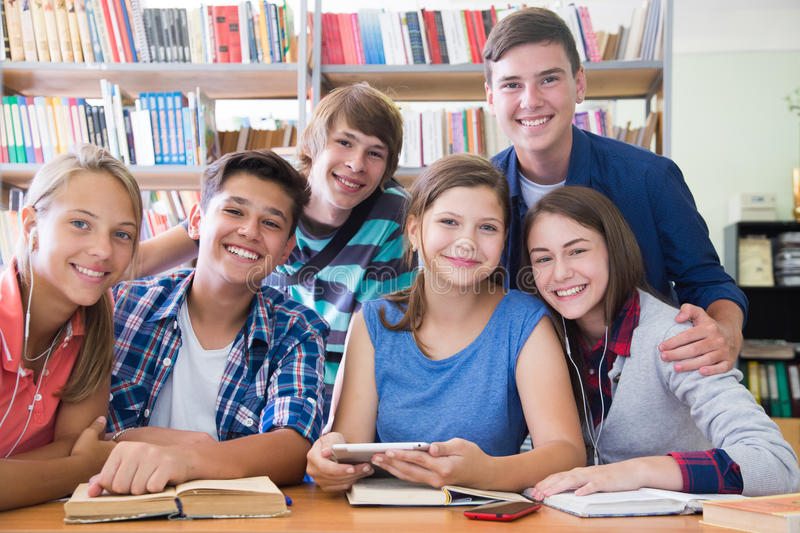 Teens in library stock images