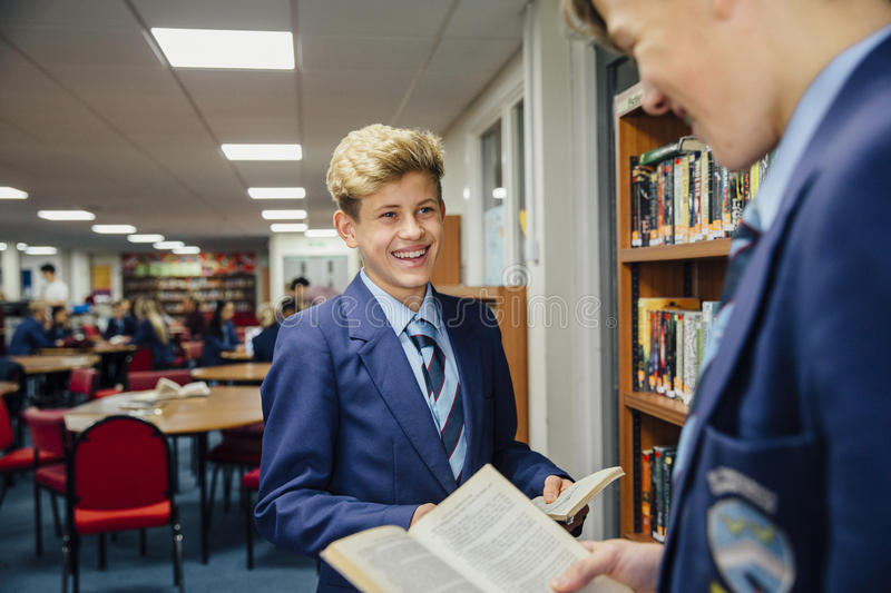 Teens At The Library stock photography