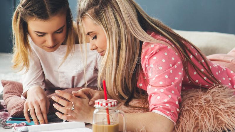 Teens lifestyle home study girl bff homework stock images