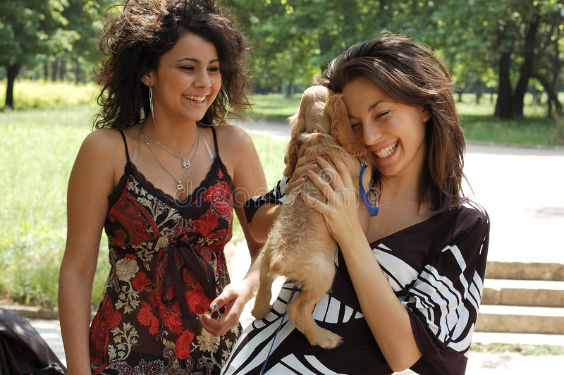 Teens with a little dog royalty free stock images