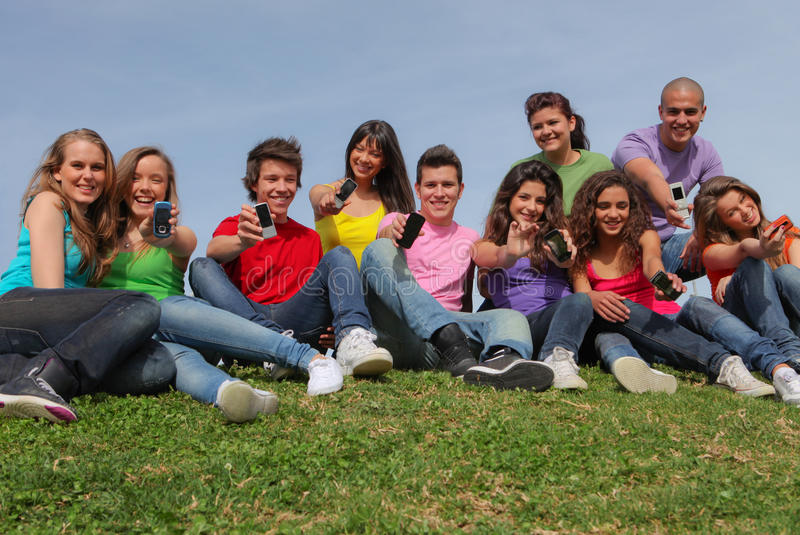 Teens mobile or cell phones. Group of happy smiling teens teenagers or kids with mobile or cell phones