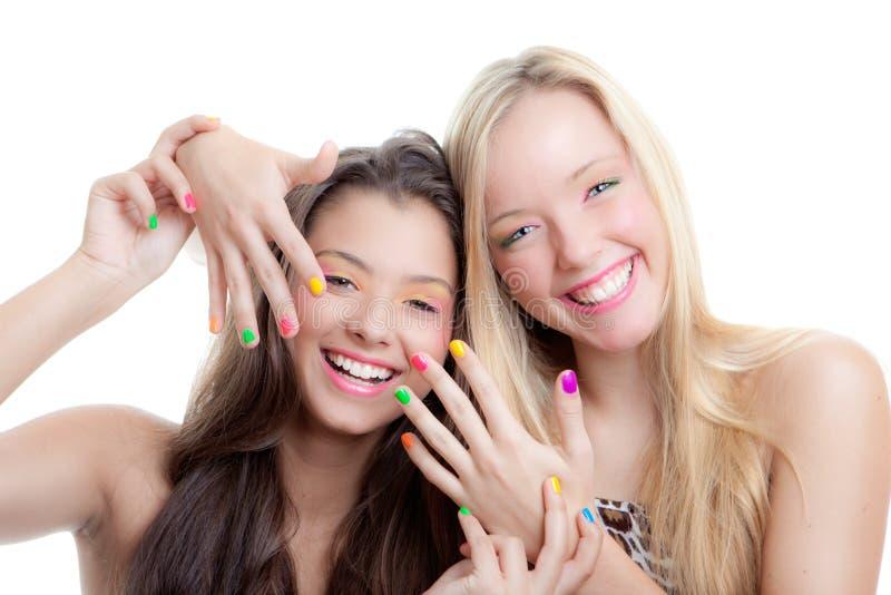 Teens nails. Young girls with bright make up and nail varnish stock images