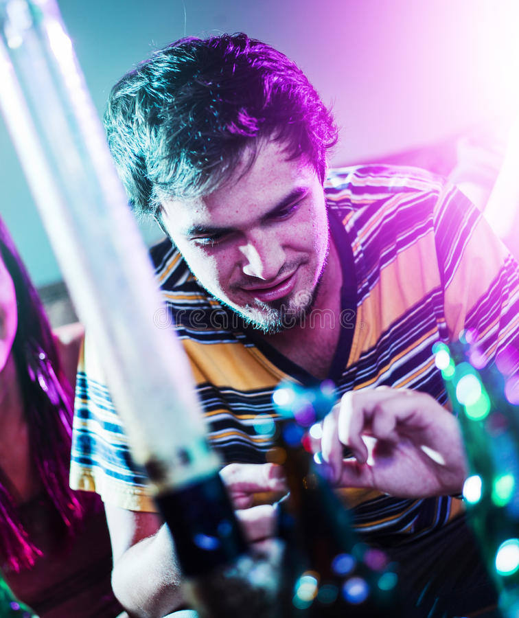 Teens at party doing drugs stock photo