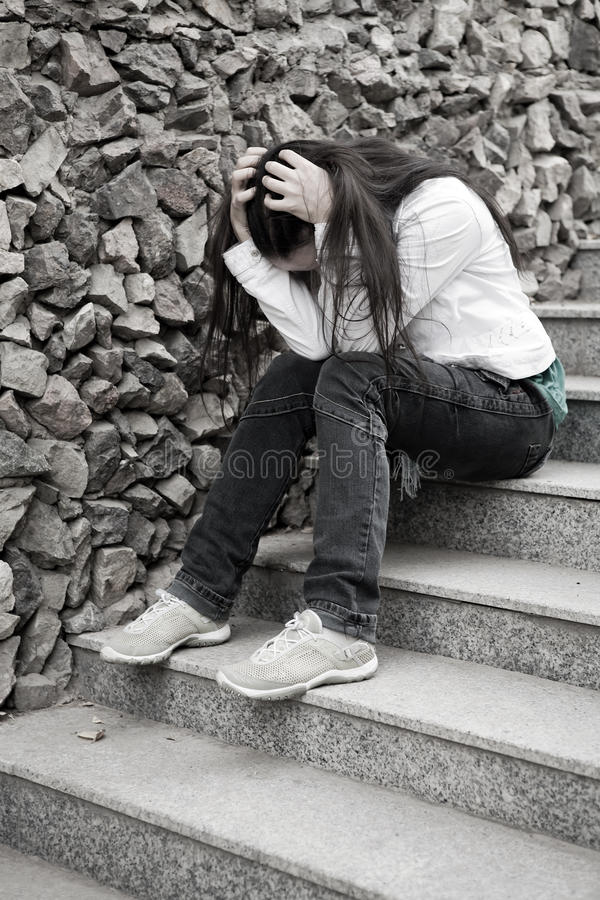Teens problems. Young woman alone at city royalty free stock image