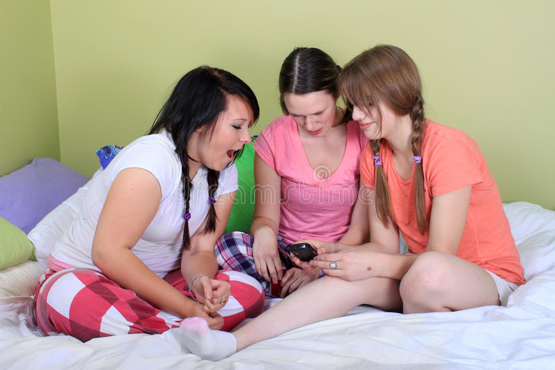 Download Teens Reading Text Messages Stock Photo - Image: 16274298