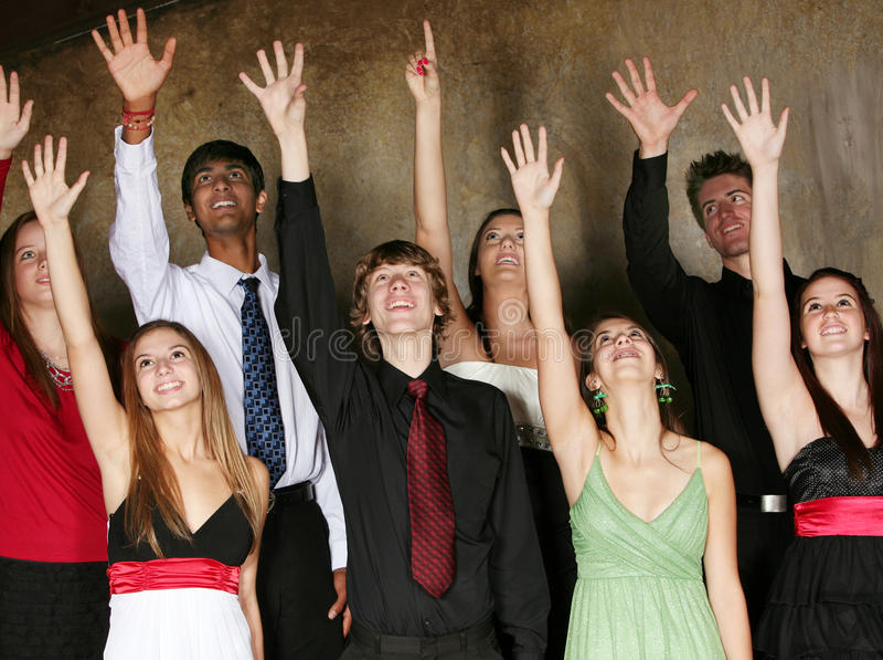 Teens singing in choir. Teens singing and performing in choir in formal dress stock photo