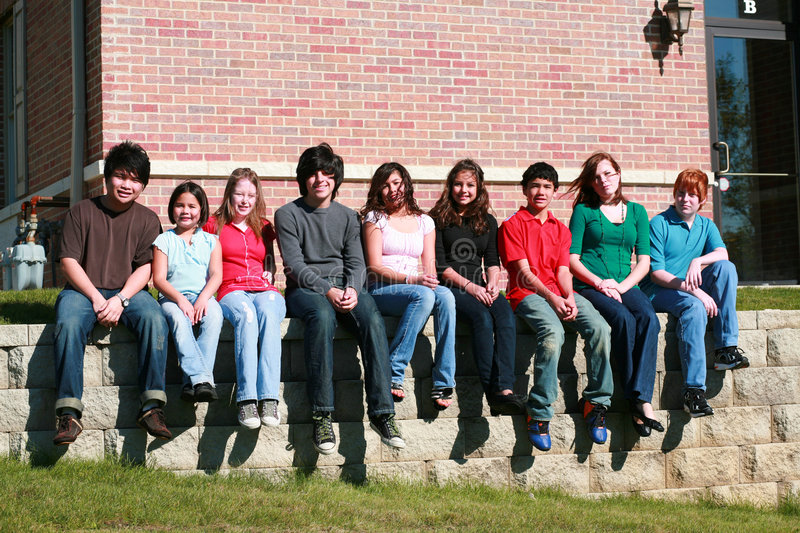 Download Teens Sitting On Stone Wall Stock Photo - Image: 7235914
