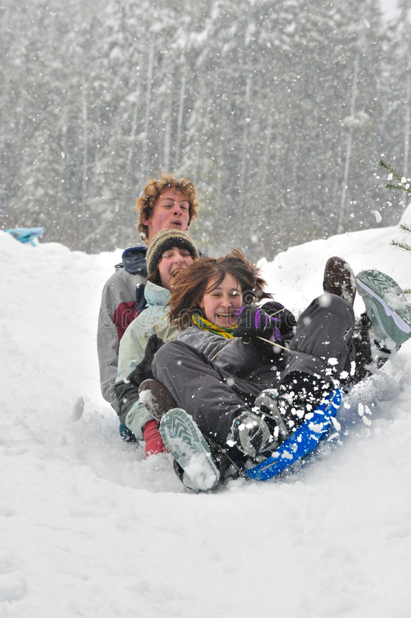 Download Teens sledding on a saucer stock photo. Image of jacket - 7590078