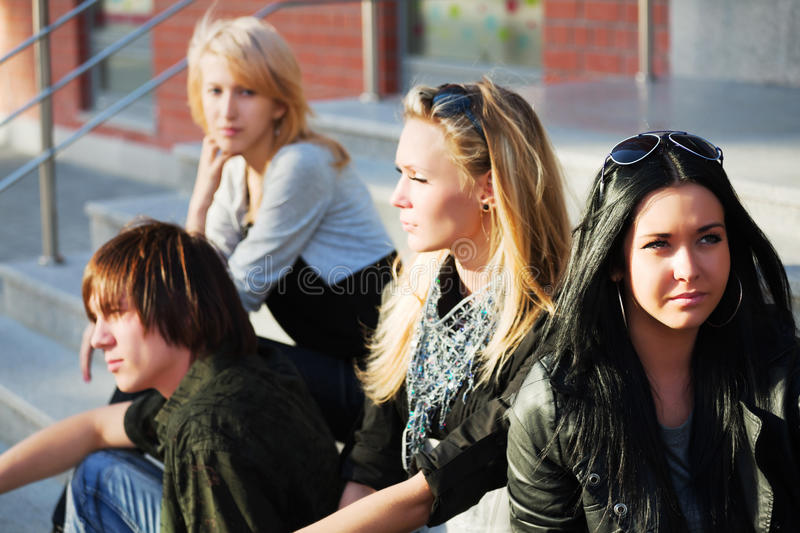 Young fashion teens sitting on steps