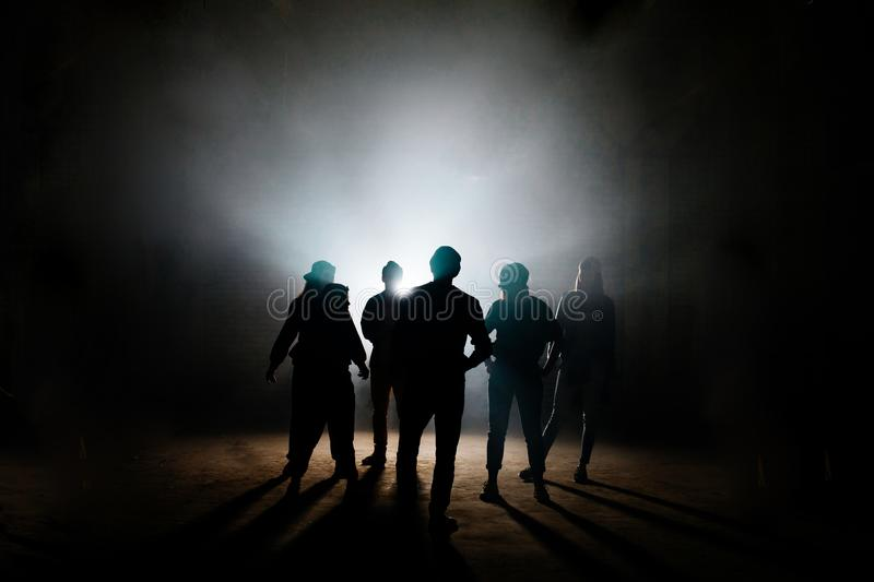 Teens taking part in hassle on the dark side street. Conflict among people. making up motions for dance. discussing problems on the street royalty free stock photos