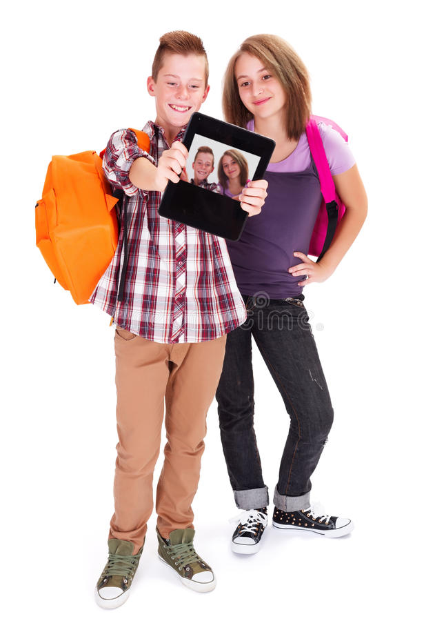 Teens Taking Self Portrait With Tablet PC Royalty Free Stock Image