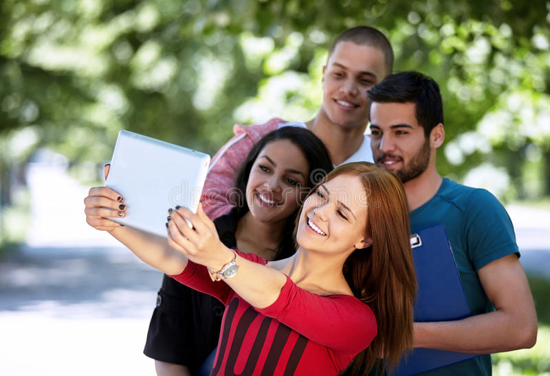 Teens taking selfie outside royalty free stock photography
