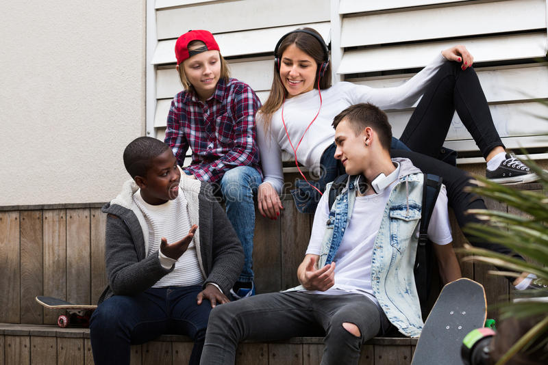 Teens talking in sunny day royalty free stock images