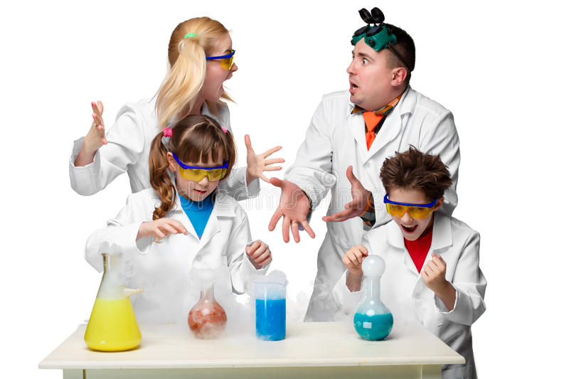 Teens and teachers of chemistry at lesson making. Teens and teachesr of chemistry at chemistry lesson making experiments isolated on white background stock photography