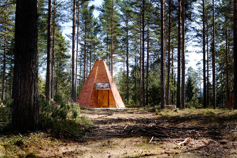 Teepee Cabin in Forest. A teepee cabin hut in the forest stock images