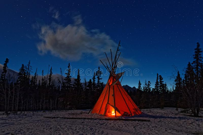Teepee in the forest at night stock photo
