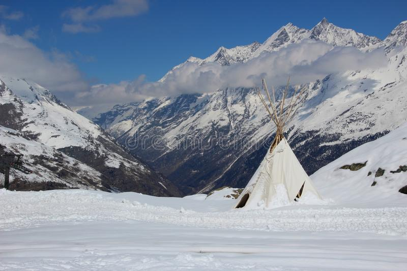 Teepee high in the Swiss Alps. Indian style teepee tent set high up in the Swiss Alps royalty free stock image