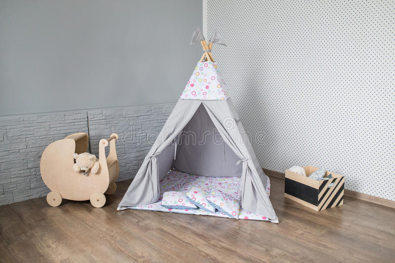Teepee in room. Bright baby room interior with a teepee stock photo