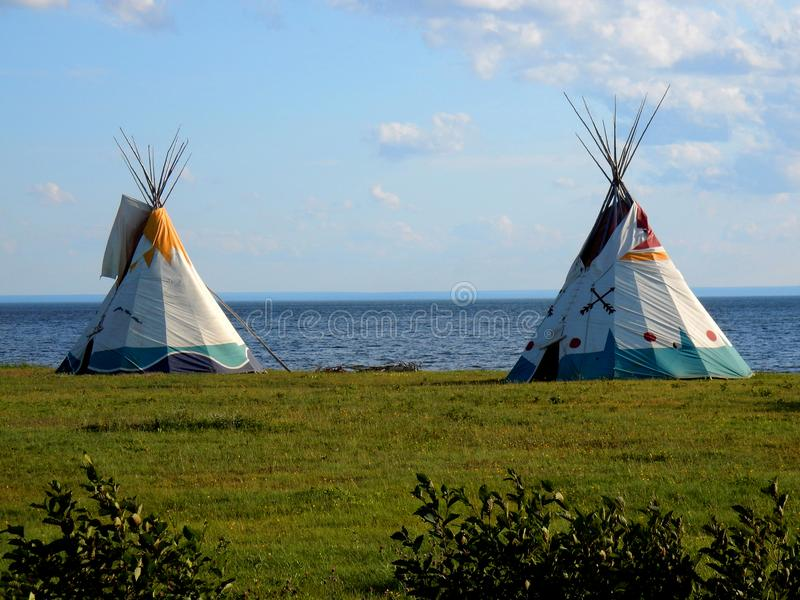 Teepee on the side of the water. Near Maria in Gaspesie royalty free stock photography