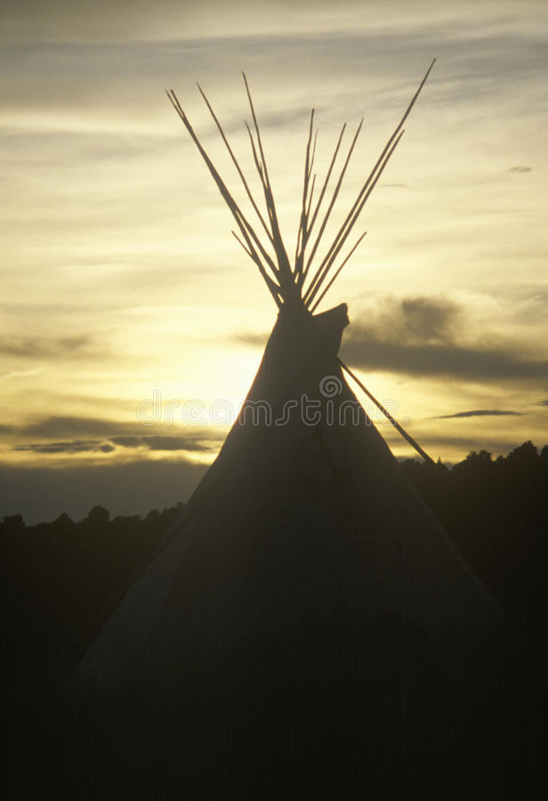 Teepee silhouetted at dusk in Taos, NM stock photography