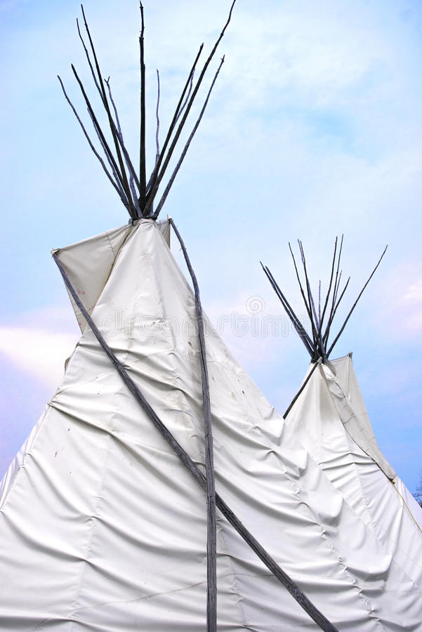 Teepee or wigwam tops. Detail of Teepee or wigwam topsagainst blue sky stock photos