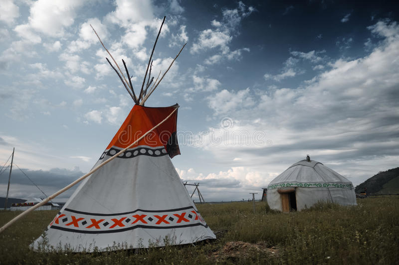 Teepee and yurt. Set on the meadow royalty free stock photo