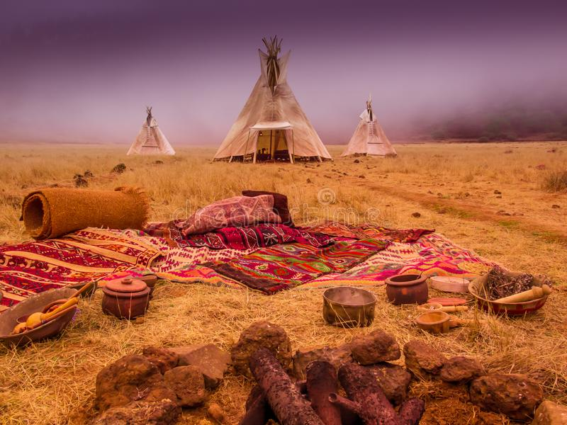 American native tent camp teepees. Teepees tent camp, home of the ancient Native Americans royalty free stock image