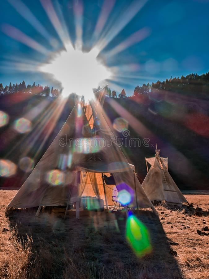 American native tent camp teepees. Teepees tent camp, home of the ancient Native Americans stock image