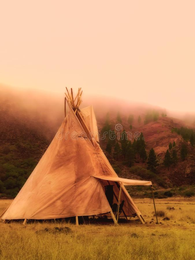 American native tent camp teepees. Teepees tent camp, home of the ancient Native Americans stock photo