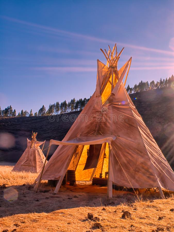 American native tent camp teepees. Teepees tent camp, home of the ancient Native Americans stock photos