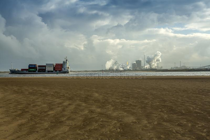Teesside Industrial Complex and Container Ship stock photography