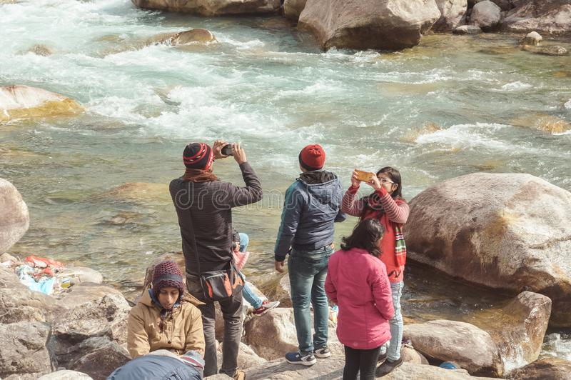 Teesta River front, Yumthang Valley, January 1 2019: Tourist people taking selfie too close to River after a recent news that royalty free stock image