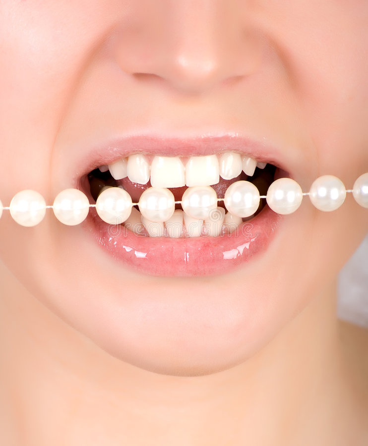 Teeth Biting On Faux Pearls Royalty Free Stock Photo