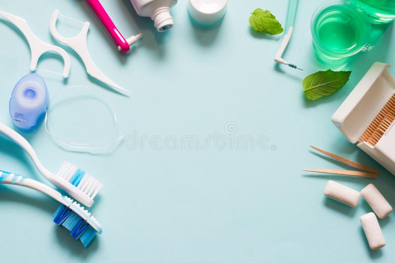 Teeth care frame concept with manual toothbrushes and oral hygiene products. Background royalty free stock photo