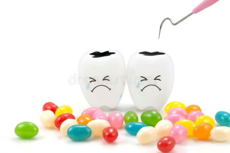 Teeth crying emotion with dental plaque cleaning tool and candy stock photography