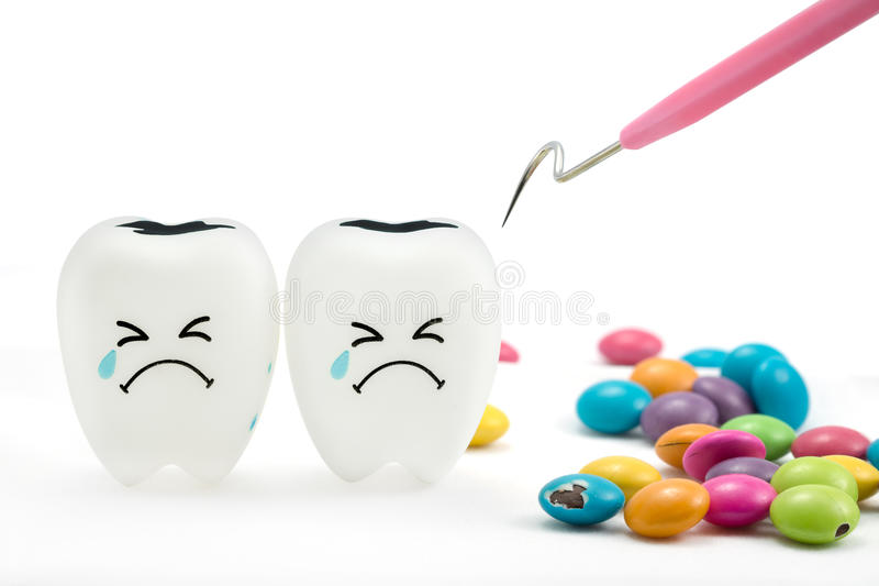 Teeth crying emotion with dental plaque cleaning tool stock images