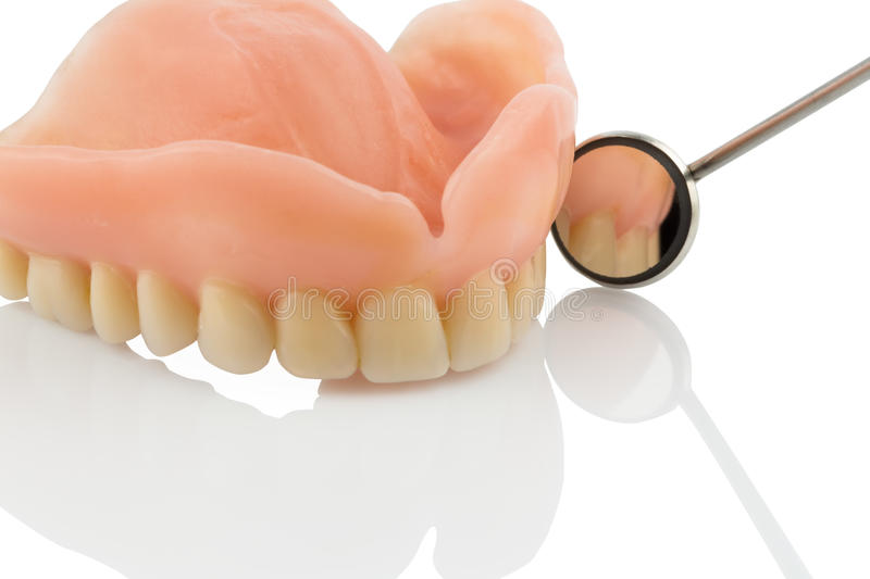 Teeth and mouth mirrors stock images