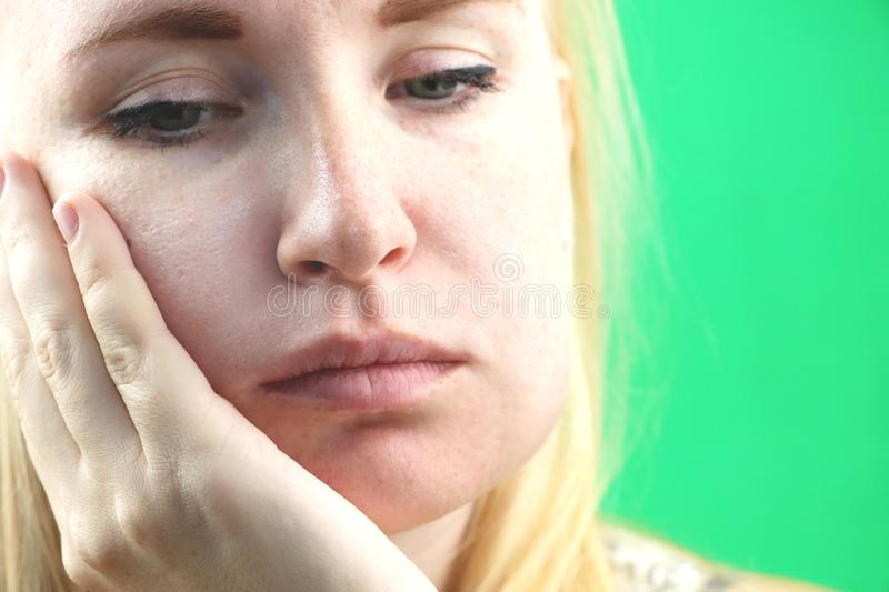 Teeth Problem. Gumboil, flux and swelling of the cheek. Closeup Of Beautiful Sad Girl Suffering From Strong Tooth Pain. Attractive. Attractive Female Feeling royalty free stock image