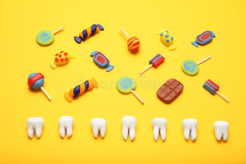 Teeth with sweet candies. Tooth caries in children`s, dental healthcare stock image