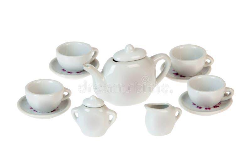Teetopfsatz, Porzellanteetopf und Schale auf Hintergrund lizenzfreie stockbilder